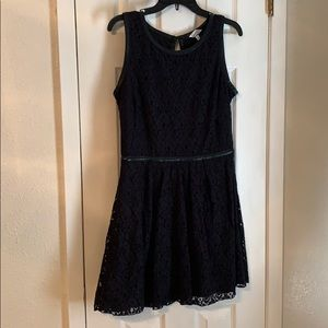 Black lace dress with faux leather detailing